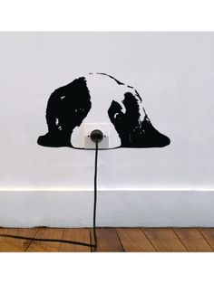 Plug into the puppy's nose. zoo chiot wall sticker for around power outlet.