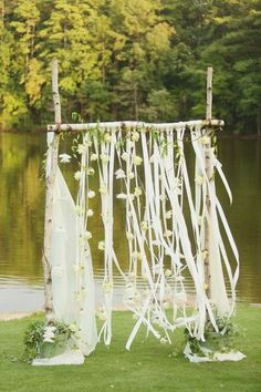 A beautiful outdoor wedding altar! A wooden arch draped with fabric, ribbon & flowers. {@Jennifer Woodbery}