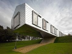 Great Suspended Building Architetcture Ideas With Modern Swing Below It