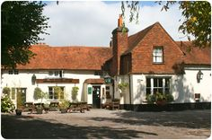 The Barley Mow in West Horsley - complete with log burner by Dorking Stoves