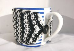 Hand knitted striped black and white cup cozy with black button