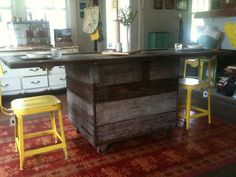 eclaimed factory cart on wheels with antique door + yellow stools || via @Olivia Gulino old made good