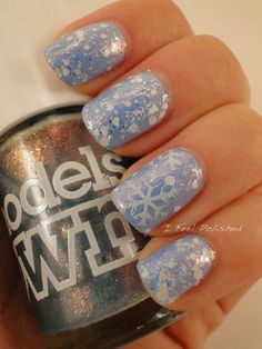 Baby blue and white snowflakes nail art design. Make your nails have that heavenly feel by painting on pretty white snowflakes over your baby blue nail polish and glitter.