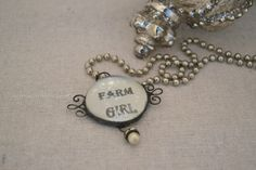 super cute! $ 20.00 Farm Girl Solder Charm ... From Rita Reade.  It is available on Etsy