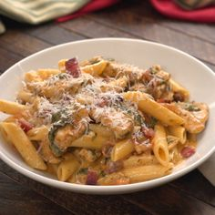 CREAMY CHICKEN BACON PASTA Serves 4 to 6 Prep Time: 10 minutes Total Time: 45 minutes  INGREDIENTS 5 slices bacon 1 pound chicken breasts (2 each), sliced Salt and pepper, to taste 2 ­½ teaspoons Italian seasoning 1 ­½ teaspoons smoked paprika ½ teaspoon red chili flakes 5 ounces baby spinach 4 to ­5 small tomatoes, diced 5 cloves garlic, minced 1 ­½ cups heavy cream 2 cups Parmesan, shredded 12 ounces penne, cooked al dente DIRECTIONS In a large skillet over medium heat, cook