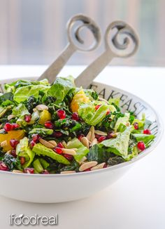 Raw kale salad with pomegranate arils, orange slices and toasted slivered almonds, drowning in guilt-free scrumptious Orange Ginger dressing.