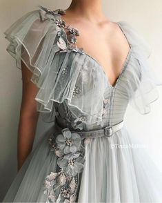 Details - Gray dress color - Tulle dress fabric with handmade details - Embroidered unique gray flowers with crystals and a velvet belt - A-line gown with waist definition V-neck and butterfly sleeves - For parties and special occasions Ball Dresses, Ball Gowns, Evening Dresses, Prom Dresses, Formal Dresses, Elegant Dresses, Sexy Dresses, Backless Dresses, Summer Dresses
