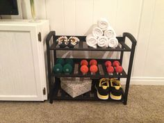 Workout room storage - shoe rack painted and turned into a shelf for weights, shoes, and towels