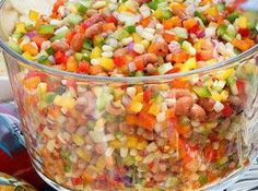Texas Caviar Recipe: 1 can of pinto beans, drained 1 can of blackeyed peas, drained 1 can of shoepeg corn 1 jalepeno 1 red onion 1 green pepper 1 red pepper 1 yellow pepper 1 orange pepper 1/4 cup oil (original recipe is 1/2 cup, but I don't think that much is necessary) 1 tsp black pepper 1 cup sugar  3/4 cup cider vinegar