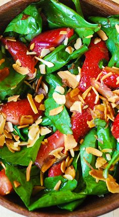 Spinach salad with strawberries, toasted almonds in a homemade balsamic vinegar based salad dressing. Gluten free, paleo, healthy recipe.