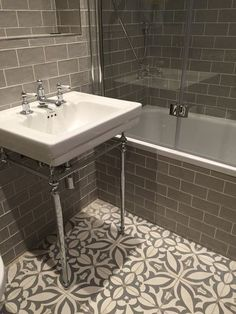 Vintage metro meets floral cement tiles in this stunning bathroom combination. Vintage metro me Bathroom Tile Designs, Bathroom Floor Tiles, Bathroom Renos, Bathroom Interior, Master Bathroom, Bathroom Ideas, Bathroom Green, Wall Tiles, Rv Bathroom