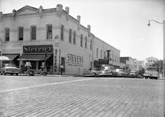 1954 Florida Memory - Commercial buildings on Monroe Street at the corner of Jefferson Street in Tallahassee, Florida.
