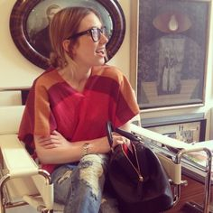 liz sporting a top from FW12, paired with distressed denim and a celine handbag.