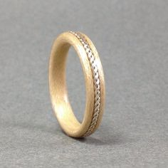 Here is a thin, yet sturdy bentwood Maple ring with a sterling silver inlay. *I have copper and Nugold (brass) on hand as well, custom orders are Wood Engagement Ring, Designer Engagement Rings, Wooden Ring Box, How To Make Rings, Beautiful Wedding Rings, Wood Rings, Ring Verlobung, Wooden Jewelry, Ring Designs