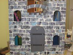The door looks MUCH better now, don't you think? Castle Dollhouse, Castle Playhouse, Toy Castle, Dollhouse Miniatures, Playhouse Ideas, Dollhouse Ideas, Castle Crafts, Castle Project, Wooden Castle