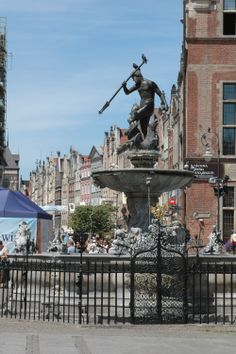 """Fountain in the middle of Old Town of Gdansk, Poland. Princess """"Star"""" Ship."""