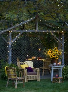 """""""Engage your backyard and make it magical for entertaining and relaxing. Corral vintage bamboo furniture, candles in colorful vintage glass,..."""