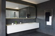 8 Reasons Why You Should Have A Backlit Mirror In Your Bathroom // They Set The Mood --- When they're the only light source in the bathroom they create a glow unlike any other. Sure a candle gives off a nice, tiny glow, but a backlit mirror that emits a soft, even glow takes a relaxing bubble bath to a whole new level.