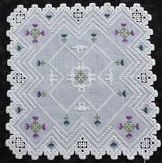"""60. 'Queenly Blooms' a 10 1/2"""" Doily pattern."""
