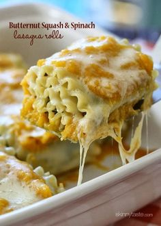Lasagna rolls stuffed with spinach and cheese, then topped with a creamy butternut parmesan sauce