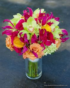 Bouquet of Pink Gloriasa Lillies, Mango Callas, Green Hydrangea, Hot Pink and Orange Roses, and Green Cymbidium Orchids