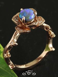 Diamond and Rose Gold Ring with a Stunning Opal Center