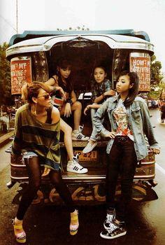 2NE1.. Ooh, they're posing on a jeepney