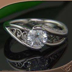 Custom Half wrap mounting with   filigree curls on each side &  Engraving on the side face.  #jewelryworks #engagement