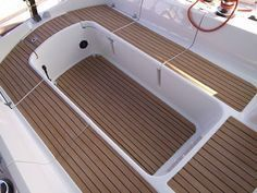 Covering cockpit with Nuteak Synthetic Teak flooring. Great product! :)