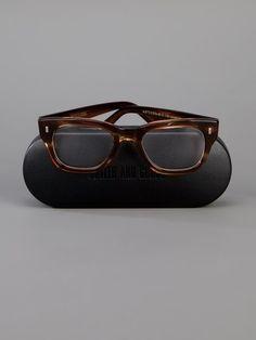 Shop Cutler & Gross wayfarer glasses.