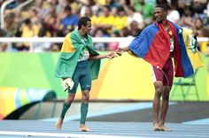 (L-R) Daniel Martins of Brazil and Luis Arturo Paiva of Venezuela celebrate after the Men's 400m - T20 Final at the Olympic Stadium on Day 2 of the Rio 2016 Paralympic Games on September 9, 2016 in Rio de Janeiro, Brazil.