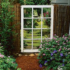 Old window used as a unique cottage garden gate.