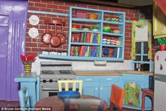 """""""Friends"""" apartment becomes a dollhouse--Iconic: The kitchen where Monica spent most of her time cooking comes complete with pans and plates"""