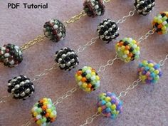 This tutorial from The Potomac Beads teaches you how to make Pretty Beaded Beads using seed beads, 8 crystal bicones, and any 4 round beads you . Beading Projects, Beading Tutorials, Beading Patterns, Video Tutorials, Beaded Beads, Beads And Wire, Beaded Starfish, Seed Bead Jewelry, Beaded Jewelry