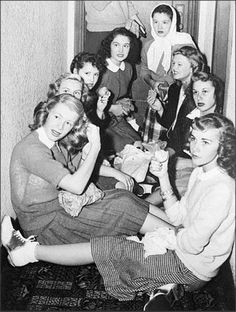 Bobby Soxers crowd in a hotel hallway waiting to catch a glimpse of Errol Flynn, 1945. Alameda, California. Tumblr