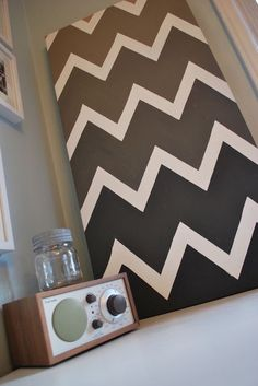 Think you can't make art? All you need for this project is a plain stretched canvas from your local art supply store, painter's tape (to mark out the chevron pattern) and paint.