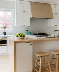 This Old House Scandinavian Modern Kitchen - butcherblock counter that warps around cabinets for an island.