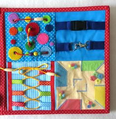 Activity fabric Board Therapy toy Toy for autistic children Sensory travel toy occupational therapy Dementia Alzhaimer stroke red special needs Activity fabric board VeryToy is an interactive board wi Diy For Kids, Crafts For Kids, Toys For Autistic Children, Fabric Board, Sensory Blanket, Fidget Blankets, Fidget Quilt, Quiet Book Patterns, Sensory Boards