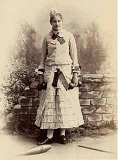 Period Photo of Young lady in sporting attire- *Note the separate blouse and skirt and glengarry type hat  Along with cycling, sporting activities of all types were becoming national pastimes. Tennis, golf, skating, swimming, hiking, mountain climbing, gymnastics, and baseball were popular. And, as more men, women, and children began participating in sporting activities, special attire was needed.   Initially, women cycled in their bustles and corsets. However, as the decade progressed…