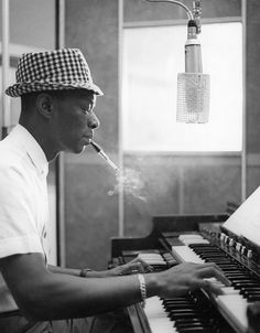 LOS ANGELES - CIRCA 1963: Entertainer Nat King Cole records at Capitol Recording Studios in circa 1963 in Los Angeles, California. (Photo by Michael Ochs Archives/Getty Images)