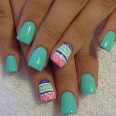 Mint nails with girly designs.