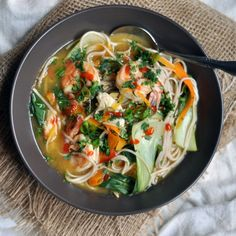 Weeknight Noodle, Vegetable and Shrimp Soup Recipe Soups with soba, vegetable broth, baby bok choy, carrots, white miso, soy sauce, salt, pepper, green onions, fresh ginger, chopped cilantro, lime, Sriracha, shrimp