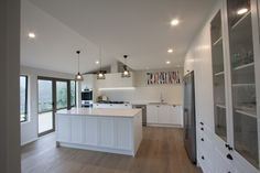 White kitchen combining contemporary and traditional features. Custom designed and made in Auckland New Zealand by LaBella Kitchens. Auckland New Zealand, Custom Design, Kitchens, Loft, Traditional, Contemporary, Bed, Furniture, Home Decor