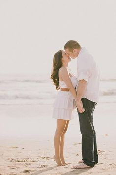 Beach Engagement Photo #kiss #tippytoes. Crystal Cove, Laguna Beach, California. | DaveRichardsPhotography.com