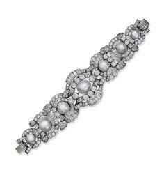 Estimate CHF 275,000 - CHF 350,000. A NATURAL PEARL AND DIAMOND BR