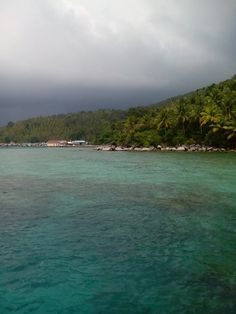 Taken from my 5 megapixel phone camera. This is the scenery at the murky afternoon in Desa Piasan (Piasan Village), Kepulauan Anambas District. Reachable by taking a 10 hours ferry ride from Tanjung Pinang, capital city of Province of Kepulauan Riau. Breathtaking.