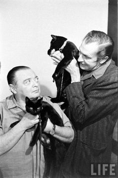 Peter Lorre, Vincent Price, and 2 black cats