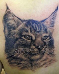 Oleg Turyanskiy - Cat Portrait Tattoo. Not the type of tattoo I would get but wow, the detailing is amazing!