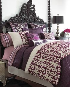 Natori Sumatra Bed Linens inspired by Suzani textiles. magenta and deep purple, chain-stitched embroidery. What kind of headboard is that?