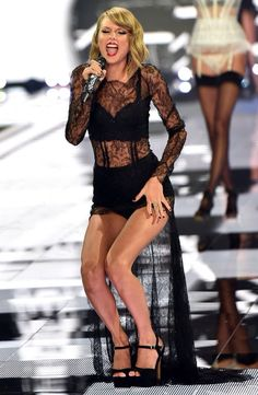Taylor Swift on runway at the annual Victoria's Secret fashion show - December 2, 2014 in London, England.